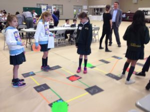 teams work on logic challenges as they move around the game board